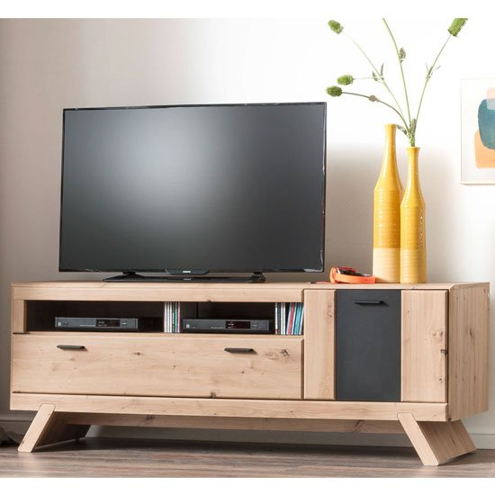 View Calais wooden small tv unit in planked oak with legs