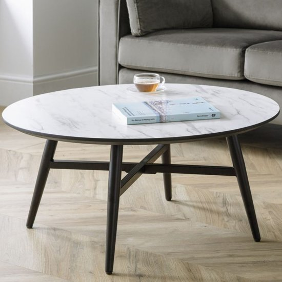 View Firenze circular marble effect coffee table with black legs