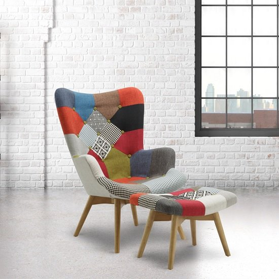 View Kendal arm chair with stool in patched and wooden legs