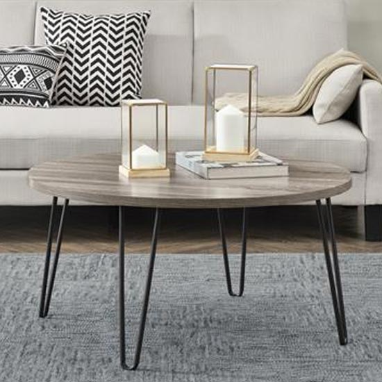 View Owen wooden round coffee table in distressed grey oak