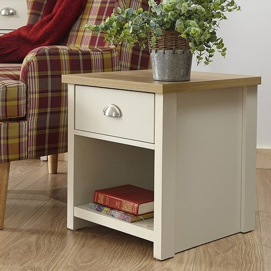 View Valencia wooden lamp table in cream with 1 drawer and shelf